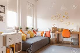 Orange Bedroom Wallpaper Yellow And Orange Accessories In Modern Teen Room Stock Photo