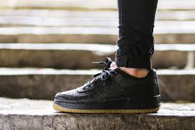 black croc and gum bottoms dominate this nike air force 1 low air force crocodile white