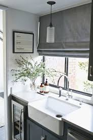 this has a really nice feel roman blind colour great and greenery in corner just nice types kitchen