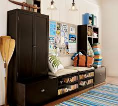 mudroom apartment storage ideas with oar floor display and versatile message board plus bench apartment storage furniture