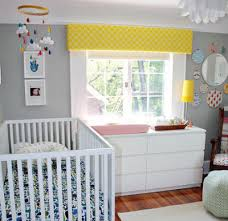 gender neutral unique baby ideas grey walls and yellow accents in this nursery baby nursery yellow grey gender neutral