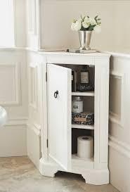 floor cabinet silver white corner bathroom cabinet under silver flower vase on marble bathr