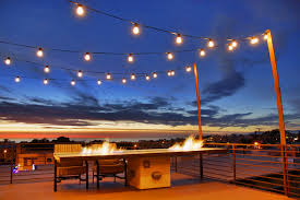 pool lights metal railing fire pit table roof deck fire table backyard string lighting ideas