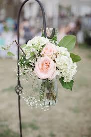 flowers wedding decor bridal musings blog: flowers lining the aisle larissa nicole photography country vintage chic wedding ideas decor