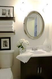 bathroom decorating ideas towel shelf toilet