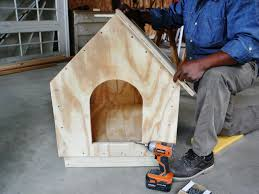 How to Build a Simple A Frame Doghouse   how tos   DIYStep   Man constructs a doghouse