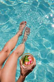 Barefoot <b>woman</b> with <b>cocktail</b> dipping bare feet in sunny <b>summer</b> ...