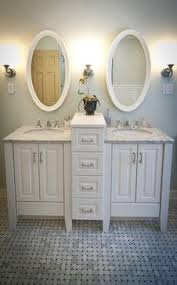 dual vanity bathroom: small double vanity for main floor bathroom not oval mirrors though