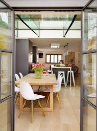family kitchen large contemporary great room idea in london with light hardwood floors cado modern furniture wing