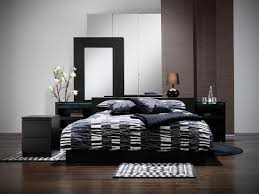 elegant low black lacquer wooden platform bed with comfortable thick queen size foam mattress covered in beautiful combination wood metal furniture