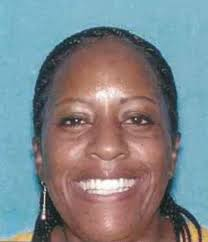 Yolanda Smith, 49, allegedly wore a white lab coat to trick her way into numerous Bay Area hospitals, where she stole employees' credit cards. - YolandaSmith-515x600
