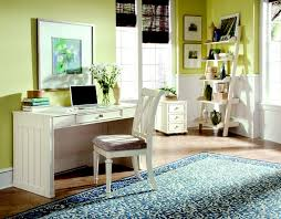 home office l shaped brown finish laminated wooden work desk_monitor desk_grey metal table legs_cream rug area_beige color finish stained plastering brown finish home office