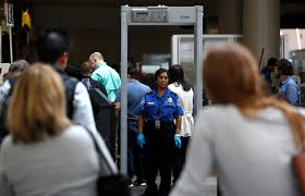airport security  tag  pbs newshour travelers stand in line to go through transportation security administration tsa check points