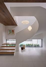 the brighton escape large trendy wooden curved open staircase photo in melbourne automatic led stair lighting