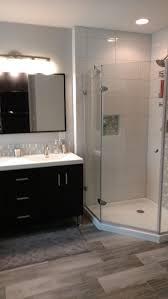 cheap bathroom flooring updated bath with frameless shower tile floors vanity mirror and light