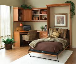 murphy bed allows you to switch between bedroom and home office with ease design bed bedroom office design ideas