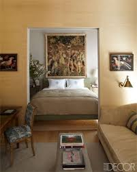 space living room olive: in a soho master bedroom the custom made bed showcases shades of muted olive the space contains an th century flemish tapestry and a rug by stark