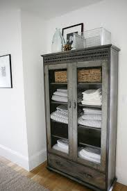 farmhouse cabinet use for linens if you dont have an extra closet bathroom furniture design