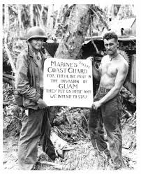 the u s coast guard at war world war ii a photo of marines holding a sign thanking the coast guard for the efforts in the