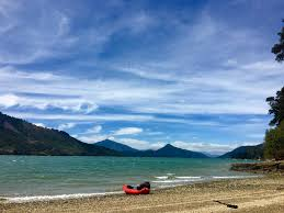 essays by date   without baggage a packraft sits on a shoreline in kenepuru sound new zealand