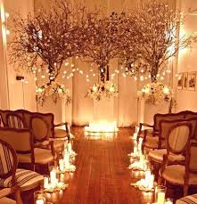 we cant help but suggest lighting your alter with lights hanging from the ceiling at different lengths hanging from manzanita branches candle light alter lighting