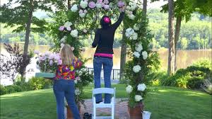 Decorating A Trellis For A Wedding Designing A Wedding Arch With Flowers Youtube