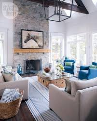 coastal casual living room with fireplace via style at home casual living room