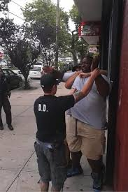 nypd probers interview officer pantaleo in eric garner death ny a still image from the ny daily news video of eric garner s fateful arrest shows