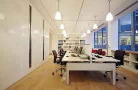 beautiful office interior designs in modern concept black swivel chairs simple chandeliers white bookshelves white beautiful office design