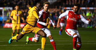 Image result for Arsenal make hard work of non-league Sutton but win in FA Cup fifth round