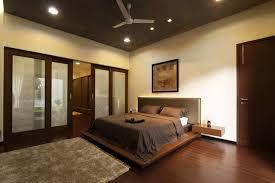 nice paintings facing double bed on amusing floor inside brown simple ceiling fan calm color in amusing white bedroom design fur rug