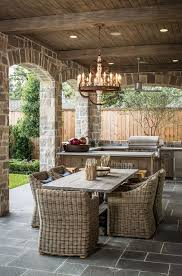 covered patio freedom properties: what a great entertaining idea for a covered patio outdoor kitchen dining table and a beautiful chandelier to complete the space