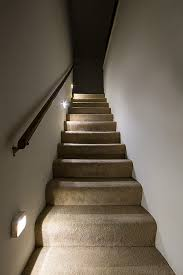 readybright wireless power outage stair light installed on wall looking up stairs application lamps staircase