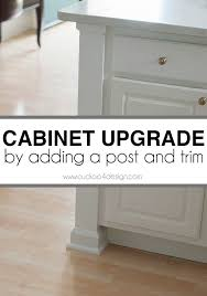 kitchen moldings: how to dress up the ends of your cabinets using a post for the corner trim molding caulk and paint you can create a custom look for very little money
