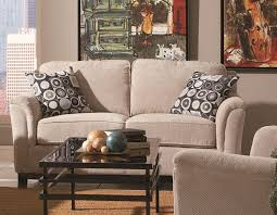 comfy fabric beige couch covered also iron rectangle coffee table frame and artwork wall portray beige furniture
