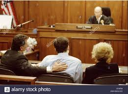 defense attorney barry levine l pats the back of double murder the back of double murder defendant erik menendez c while attorney leslie abrahmson r listens as erik and lyle are declared guilty of first degree