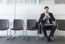 job interview tips for older job seekers man waiting in office lobby for job interview
