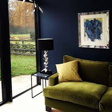 space living room olive:  dark colour makes the walls advance come towards you so is great in creating a cosy glamourous look the use of dark colour can transform a dull room