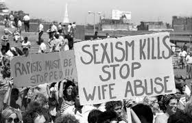 domestic violence in the s circulating now crowd of people ing holding anti domestic violence signs that rapists must be