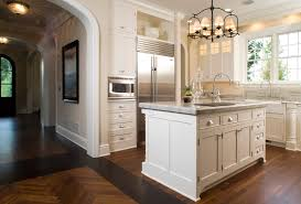 modern kitchen cabinet hardware traditional: wolf microwave drawer kitchen traditional with archway baseboards bin pulls chandelier chevron pattern