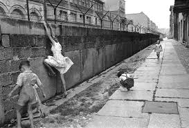 west german children play on the newly erected berlin wall  west german children play on the newly erected berlin wall 1962
