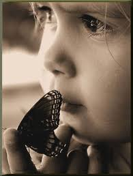 Butterfly As a young girl of 7, who loved to wander outside and look at everything, ... - girl-butterfly