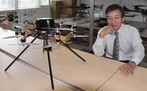 drone being developed to fly autonomously inside fukushima reactor chiba university professor kenzo nonami poses a drone prototype in chiba on 2014