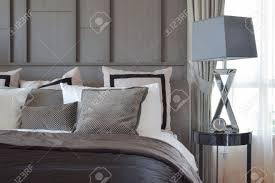 table bed bedroom royalty stock photo stylish bedroom interior design with black patterned pillo
