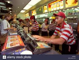 multi national staff stock photos multi national staff stock staff serve customers at the mcdonalds branch in brent cross london england stock image