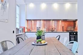 copper backsplash tile unfinished cabinets