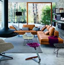 love the tan leather couch and the pops of fuchsia bedroomterrific eames inspired tan brown leather short