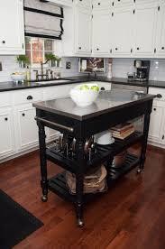 wheeled kitchen islands white kitchen with dark portable kitchen island on wheels