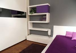 updated bedroom in masculine look with mounted shelving unit in white color affordable and beautiful modern bedroom designs bedroom simple modern bedroom design