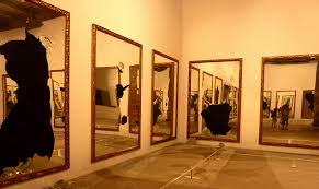 mcneill life stories venice biennial contemporary art exhibition broken mirrors covered the four walls of this room